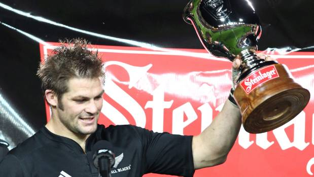 All Blacks captain Richie McCaw holds the Steinlager Trophy aloft after a series win over Wales in 2010.
