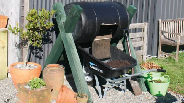 a rotating compost bin is a mouse proof option for turning kitchen scraps into food for