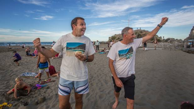 Duane Major, left, and Adam Gard'ner at a party at Sumner beach to celebrate the purchase of an Awaroa Inlet property.