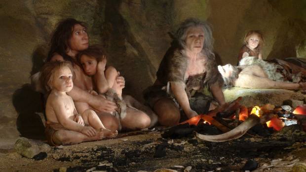 An exhibit shows the life of a neanderthal family in a Neanderthal Museum.