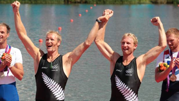 Eric Murray and Hamish Bond celebrate on the podium after winning gold in the men's pair at the London Olympics.