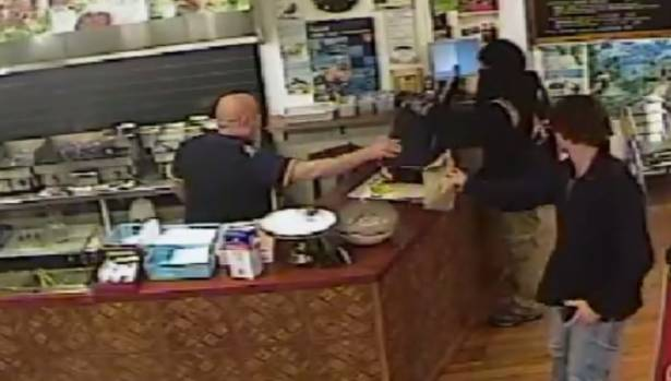 CCTV footage shows a man, armed with a hand gun, enter Souvlaki restaurant on Papanui Rd, Christchurch about 10.38pm, May 28.