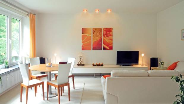 The lighting in this room can also change colour at the touch of a button, thanks to the iDual globes and remote control.