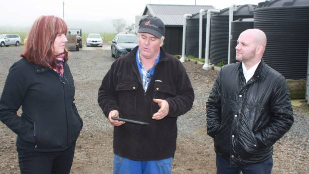 Waiuku dairy farmer Tony Walters talk tech with Fonterra general manager of operations and farmer services Evelyn ...
