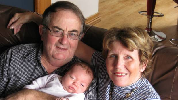 Mary with husband Doug and her granddaughter, Grace, a year after she was diagnosed with Alzheimers.