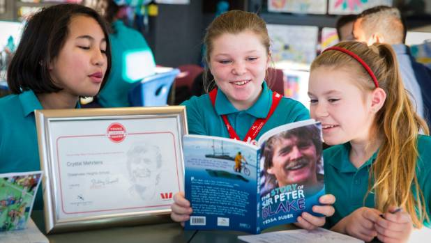 Eleven-year-old Crystal Mehrtens, centre, shares the story of Sir Peter Blake with her Oceanview Heights School ...