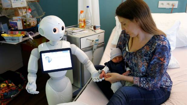 "New recruit ""Pepper"" the robot, a humanoid robot designed to welcome and take care of visitors and patients, holds the ..."