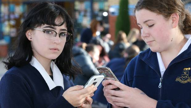"Marlborough Girls' College students Lisa Boult, 16, left, and Abbe Johnston, 16, say ""like for a name"" is about public ..."
