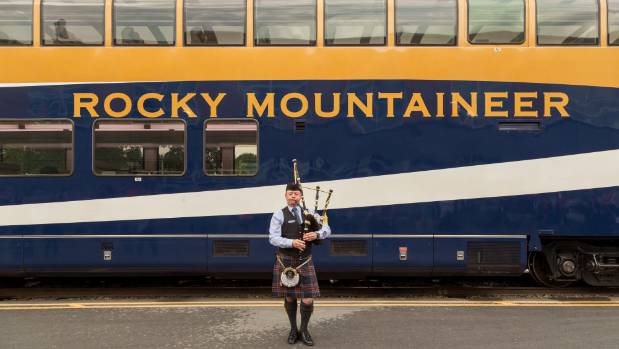 A piper welcomes guests on the Rocky Moutaineer at Vancover's purpose-built train station