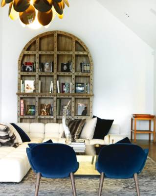 Mad chairs from Studio Italia sit in the foreground; the large wooden bookshelf, which can be split into four pieces, ...
