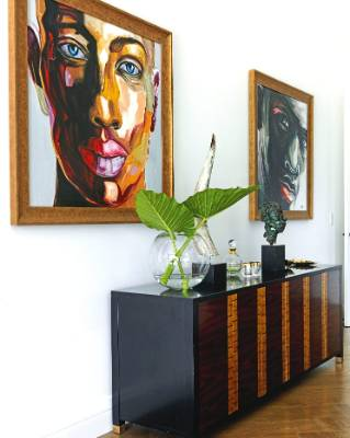Dave sourced the two portrait paintings online five years ago, and the sideboard is from Cavit & Co.