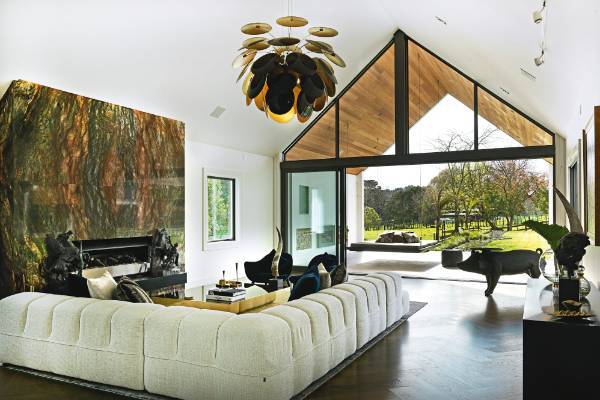 The Marset Discoco pendant from ECC hangs above the formal living room in Michelle and Dave Blanchard's home; the ...