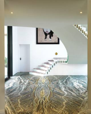 The lobby flooring is polished Jurassic travertine.