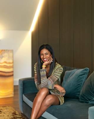 Michelle sits on a Leonard sofa in Hunt velvet in Petrolio from ECC.