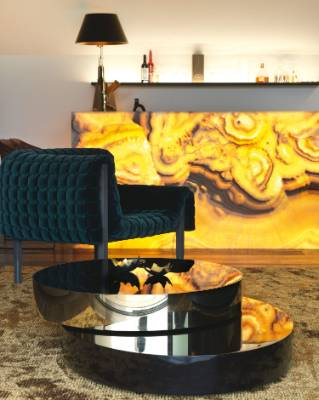 Dave wanted a bar that glowed – his brief was fulfilled with illuminated onyx arco stone; the Ruché chair by Ligne Roset ...