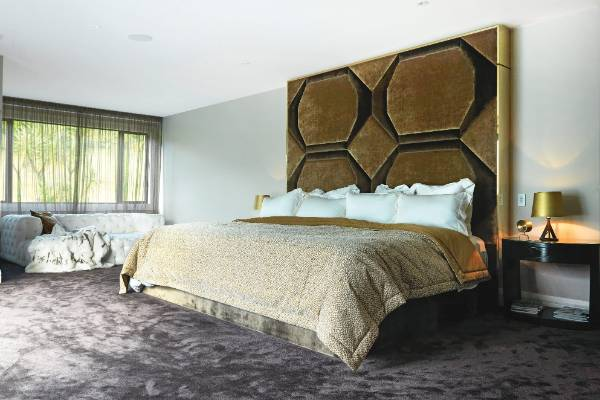 The master bedroom features a custom-made bed (two double beds joined together) with made-to-measure bedspread and linen.