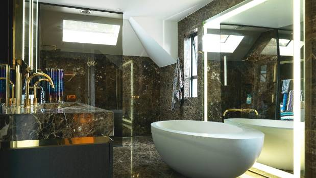 The en suite features honed Emperador Dark marble slab from SCE and a SpazioCasa free-standing bath; Michelle ensured ...