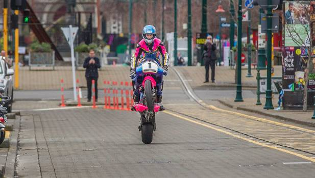 Champion rider Andrew Stroud wheelstands the Britten V1000 superbike up Worcester Boulevard to the Christchurch Art Gallery.