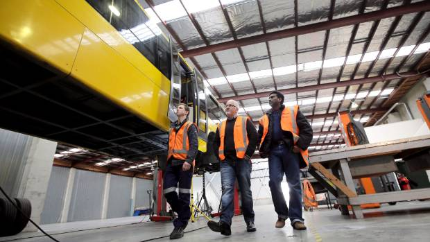 Wrightspeed project manager Sytse Tacoma, NZ Bus chief executive Zane Fulljames and NZ Bus project manager   Sudhakar ...