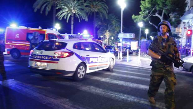 French soldiers and police secure the area in Nice, France, after a truck ran into a crowd celebrating the Bastille Day ...