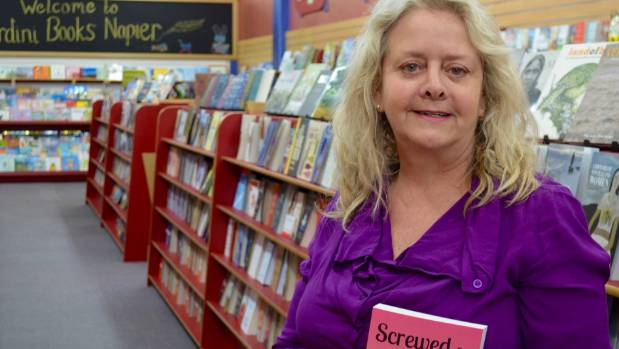Andrene Low with her new book before its launch at Wardini Books in Napier.
