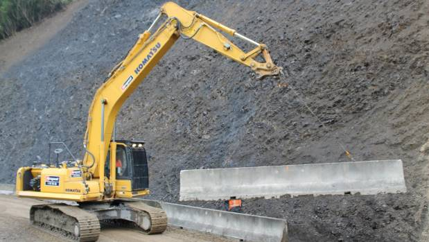 A barrier is lifted into place at Blue Bluff, as Otaki Gorge Rd is reopened.