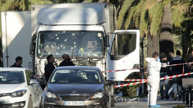 Forensic police investigate a truck at the scene of a terror attack on the Promenade des Anglais in Nice, France.
