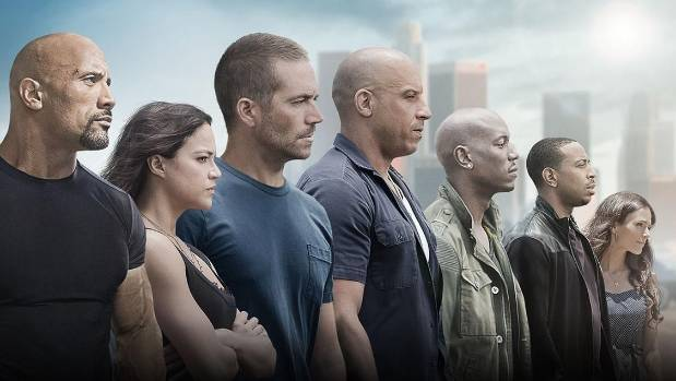 The Fast and the Furious 7's cast includes, from left, Dwayne Johnson, Michelle Rodriguez, the late Paul Walker, Vin ...