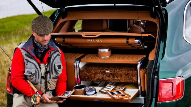 The accessory kit slips into a rear of the Bentley, and can be removed.