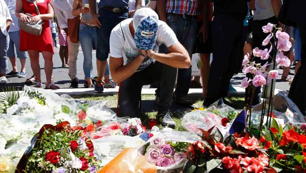 A man reflects on the horror of the Nice attack amid bouquets left in  tribute to the victims, who died nearby.