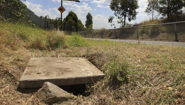 The drain where the baby was found in Sydney. He survived and has met all his milestones as a healthy 20-month-old.