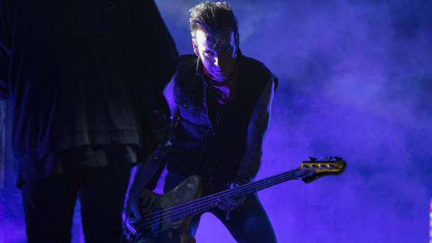 Bass player Simon Gallup brings the noise.