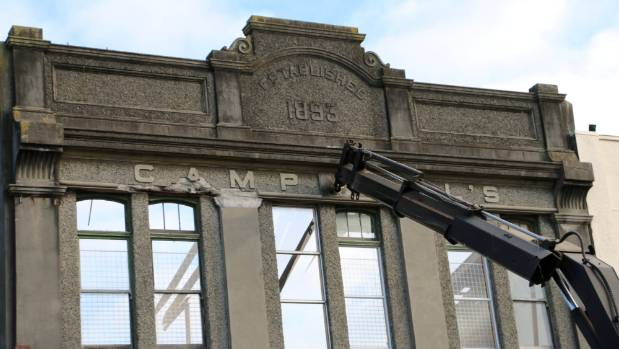 A hi-ab truck was used to support the facade of the 123-year-old Campbell building during the demolition in Hawera's ...