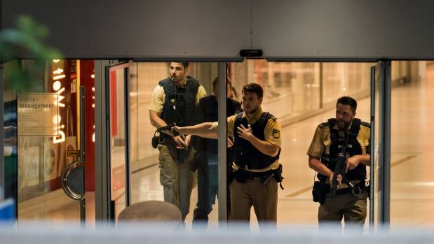 Authorities were evacuating people from the Olympia mall but many others were hiding inside.