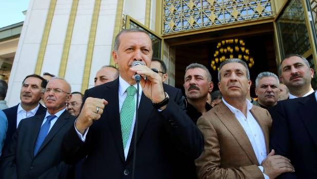 Turkish President Tayyip Erdogan addresses his supporters after Friday prayers in Ankara.