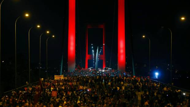 Pro-government demonstrators march over the Bosphorus Bridge.