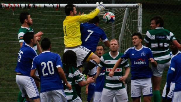 Wellington Olympic goalkeeper Scott Basalaj fights to clear the ball in Olympic's 7-2 win against Palmerston North Marist.