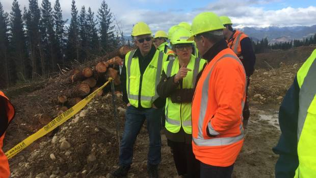 Associate Minister of Primary Industries Jo Goodhew, centre, visited the site of the tele-operation demonstration at ...