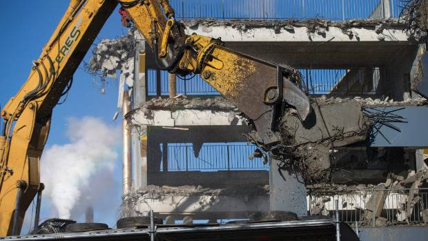 Christchurch Hospital's old Antigua St parking building being demolished in late July.