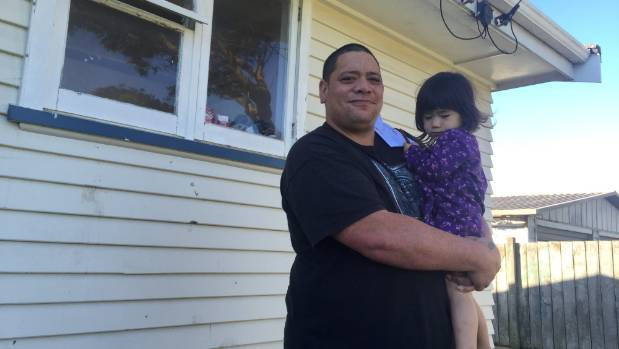 Housing New Zealand tenant Lyle Walker and his daughter Amy Walker, 2, at their Otaki home.
