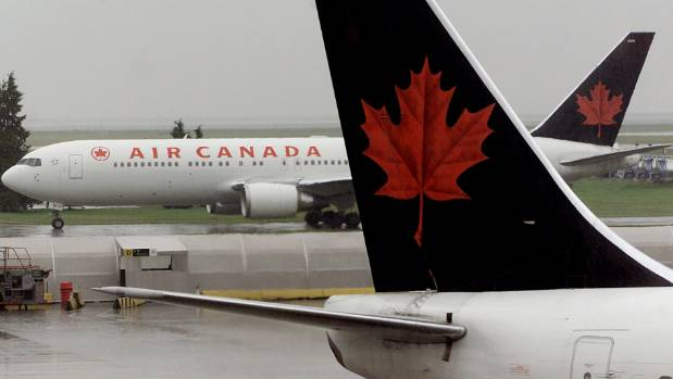 Air Canada plane diverted after passenger tries to open door