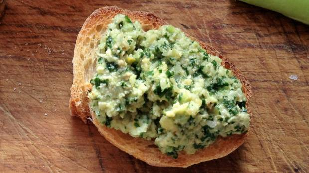 Turn broccoli stalks and leafy bits into pesto that can be used as a dip, sauce or  spread for baguette ends.