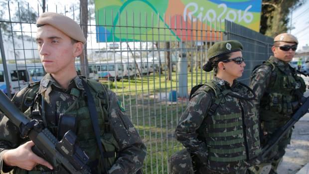 Military personnel stand guard outside the 2016 Rio Olympics Village in Rio de Janeiro, Brazil.