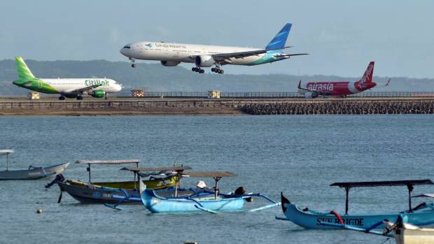 A Garuda Indonesia plane lands at Ngurah Rai International Airport on the Indonesian resort island of Bali.