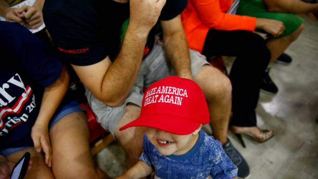 Supporters listen as Republican US Presidential nominee Donald Trump attends a campaign event in Pennsylvania.