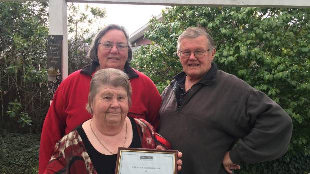 Wairarapa Lifeline lifetime members Kevin and Val Ball and Tina Goodin with the 1987 Lifeline Wairarapa Certificate of ...