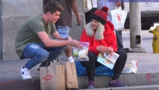 The moment Brooke Roberts met missing mother Jaime, and offered her some food.  Photo: Youtube / Prank Nation