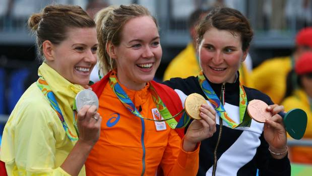 Anna van der Breggen wins gold in the Olympic women's road race, flanked by Emma Johansson of Sweden (silver) and Elisa ...