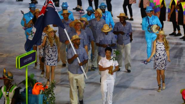 Flag bearer Forbes Ronald of the Cayman Islands leads his team.