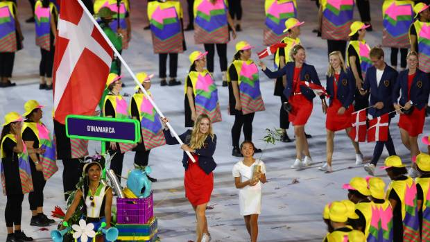 Caroline Wozniacki of Denmark carries the flag during the Opening Ceremony.